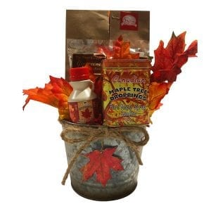 Canadian Made Gift Basket with gourmet maple pumpkin seeds, maple syrup, a tin of maple candies, beaver droppings, moose droppings and oven roasted maple pecans