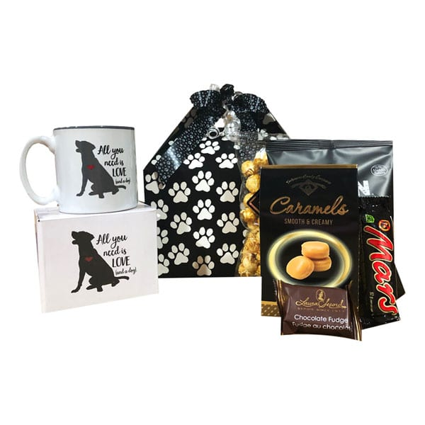For The Dog Lover Gift Basket contains a dog themed mug, caramels, chocolates,fudge, caramel corn, snack mix