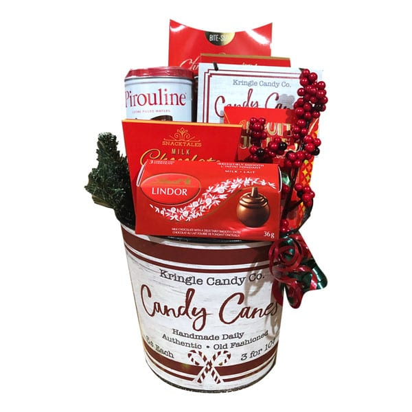 Kris Kringle Gift Basket filled with gourmet food items and a matching ornament