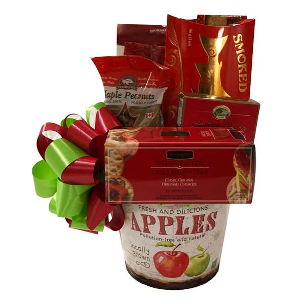 Sustenance Plus in this vibrant basket filled with peppermints, biscotti, crackers, corn nuts, smoked salmon, maple nuts, gouda cheese and almond roca