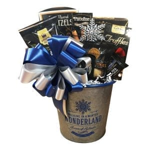 Winter Wonderland gift basket filled with cookies, pretzels, chocolates, shortbread, sweet and savory snack mix