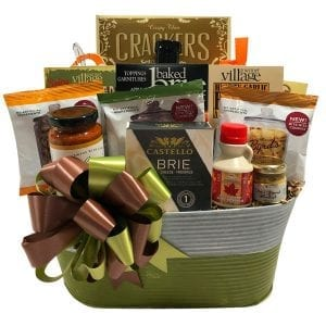 Chef's Blend Gift Basket is filled with antipasto, brie cheese, burger and fries seasoning, bottle of sriracha bbq sauce, brie topping, maple fudge, gourmet ice tea, ground mustard, cookies and maple syrup.