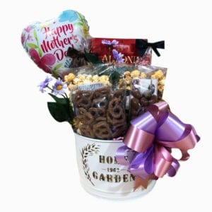 Home and Garden Treasures Gift Basket with chocolate pretzels, biscotti, chocolate barks, almond roca and chocolate drenched popcorn.