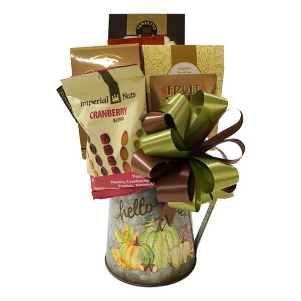 Hello Fall Gift Basket is two gifts in one. A beautiful metal pitcher and a delicious assortment of decadent treats.
