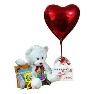 Deluxe Cupid's Bounty with nut free product, a large bear and a helium heart balloon