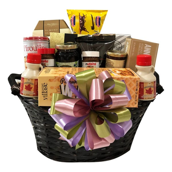 Breakfast Buffet Gift Basket with pancake/waffle mix, Nutella, coffee, tea, maple syrup, almond thins, biscotti, marble pound cake, jam, fruit spread, shortbread and wafers.