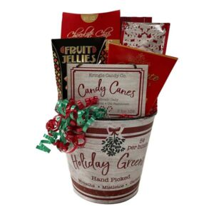 Kris Kringle Gift Basket, cookies, hot chocolate, chocolates, candy and a Christmas Ornament are all included in this gift.