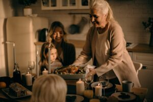 grandmother putting food on table