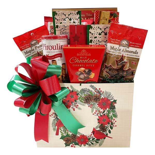 Poinsettia Perfect Gift Basket filled with cookies, chocolates, kettle corn, maple treats, cookies, hot chocolate, etc.